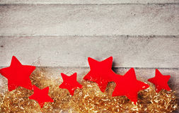 Red stars on wooden background Stock Images