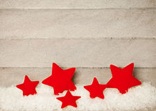 Red stars on wooden background Royalty Free Stock Image