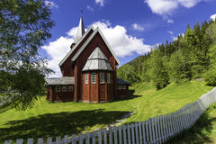 Red Stave Church on a Sunny Day Stock Photo
