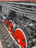 Red steam engine wheel, metal connected pipe, Royalty Free Stock Photo