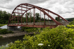 Red Steel Arch Road Bridge - Gilboa, New York. A cloudy view of a red steel arch road bridge at Gilboa, New York Royalty Free Stock Image