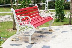 Red steel bench with white armrest  chair Royalty Free Stock Photography