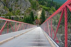 Red Steel Bridge. Over Hell's Gate on the Frazer River, Canada Royalty Free Stock Photos