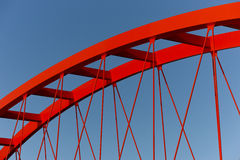 Red steel bridge. Against a blue sky Stock Photo