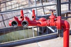 Red steel fireplug on a street Royalty Free Stock Photo