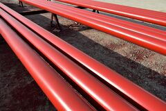Free Red Steel Pipes For Fire Fighting System And Extinguishing Water Lines In Industrial Building. Paint Shop. Steel Pipe Painted Red Stock Photo - 198100220