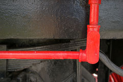 Red steel tube for oil on black train Stock Photos