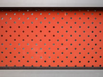 Red steel wall with a lot of hole. Close up Royalty Free Stock Photos
