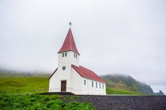 Church in Vik, Iceland. Red-steepled church  in the town of Vik in Iceland Royalty Free Stock Photography