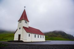 Church in Vik, Iceland. Red-steepled church  in the town of Vik in Iceland Royalty Free Stock Photo