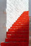 Red steps. In a picturesque greek island Stock Image