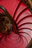 Red steps on snail stairs Stock Photo