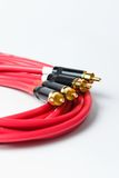 Red stereo RCA audio cables. Set of professional studio wires on white background Royalty Free Stock Photography