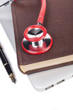 Red Stethoscope on Book Stock Images