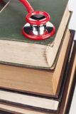 Red Stethoscope on Books Stock Photo