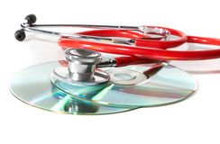 Red stethoscope with cds Royalty Free Stock Photos