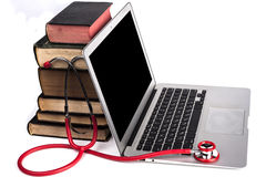 Red Stethoscope and Laptop Royalty Free Stock Image