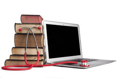 Red Stethoscope on Laptop Royalty Free Stock Photography