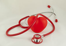 Red stethoscope and red heart Royalty Free Stock Images