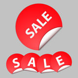 Red sticker with the text of sale Royalty Free Stock Photos