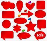 Red stickers set with colored pushpins. Royalty Free Stock Images
