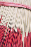 Red Sticks of Incense in Decorative Ribbon Royalty Free Stock Photo