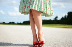 Red Stiletto shoes on woman's feet. Red high heel shoes in summer sunshine of Florida royalty free stock photography