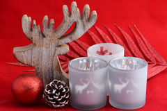 Red still life background with grey, white wooden reindeer Christmas decoration lights Royalty Free Stock Photos