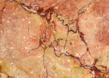 Red stone. Structural red stone with yellow and brown Royalty Free Stock Photo