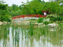 A red stone bridge over a lake Royalty Free Stock Photo