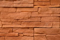Red stone cladding texture. Rough red stone cladding texture from sandstone Stock Photography