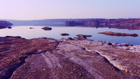 Red Stone coast near the lake stock video footage