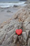 Red Stone Heart on Rocky Shore Royalty Free Stock Photos