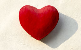 Red Stone Heart on The wall Stock Photography