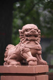Red stone lion Stock Photo