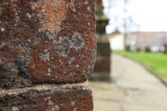Red Stone. Peering around the edge of the red stone architecture of a church in Standish, Wigan Royalty Free Stock Image