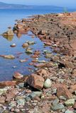 Red stone and rock formation at Storsand beach, Norfällsviken, Gulf of Bothnia royalty free stock photos