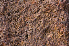 Red stone. Red rough stone in temple Stock Photography