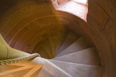 Red stone spiral. Red sandstone staircase in Rothesay Castle, Bute, Scotland royalty free stock photos