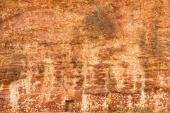 Red stone wall. Background image of red stone Stock Photo