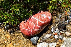 Red stone with white layers Royalty Free Stock Images