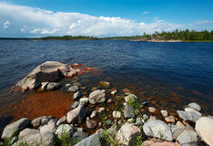 Red stones. The granite coast of Ladoga lake, wet stones have got especially bright colouring Royalty Free Stock Images