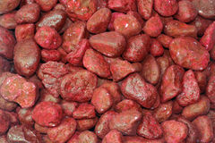 Red stones as background Stock Photos