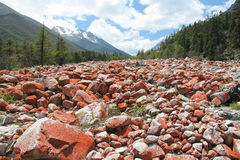 Red stones landscape in Riwuqie. Could be explained by red lichen, bacteria, or mineral Stock Photos