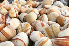 Red stones, pebbles. Stones, pebbles with red rings, for garden decoration Stock Image