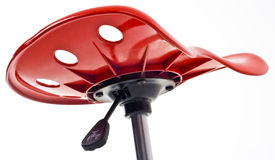 Red Stool. The underneath of a modern red office stool Royalty Free Stock Photo