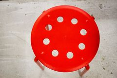 Red stool on the cement floor Stock Images