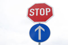 Red Stop and Blue One Way Traffic Sign Stock Photography