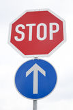 Red Stop and Blue One Way Traffic Sign Royalty Free Stock Photography