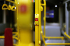 Red stop button inside double decker bus in London Royalty Free Stock Images